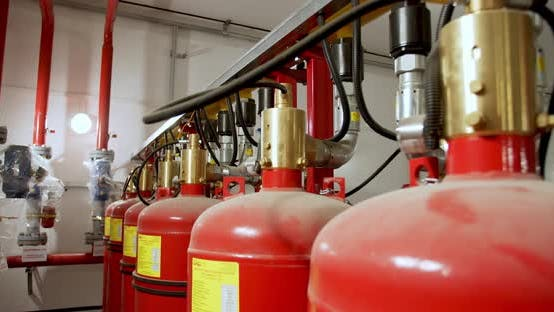 Thumbnail for Close Up of the Big Red Gas Cylinders Connected To the Pipe System
