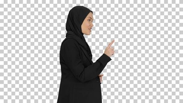 Smiling Arab woman wearing hijab talking, Alpha Channel