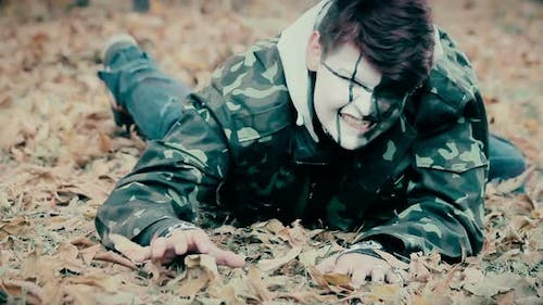 Injured Male Wearing Military Uniform Crawling, Zombie Escaping From Underworld
