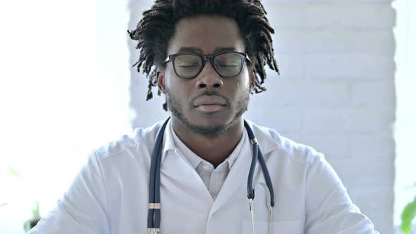 Thumbnail for African Doctor Looking At Camera