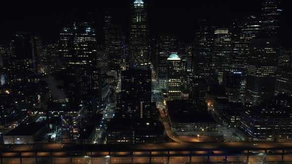 Epic Helicopter View of Seattle Skyline Skyscraper Buildings at Night