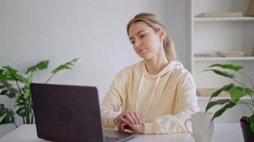 Portrait Young Tired Woman Sitting in Front of Laptop