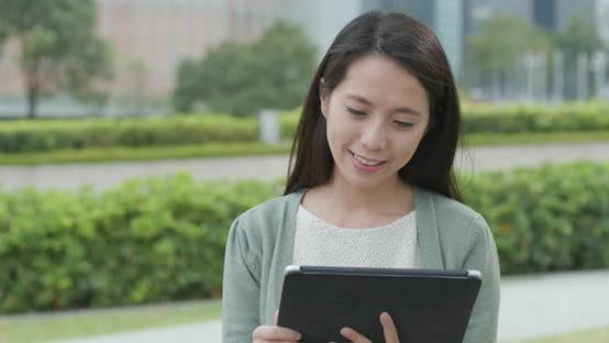 Thumbnail for Asian woman use of tablet computer
