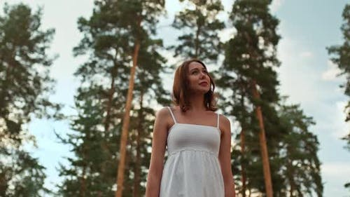 Portrait of a Beautiful Girl Walking in a Pine Forest. Rest in the Forest, Beautiful Nature. , 10Bit