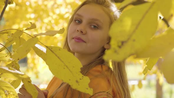 Thumbnail for Close-up of a Cute Blonde Caucasian Girl in Mustard Scarf Posing To the Camera