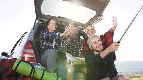 Group of Cheerful Criends Doing Selfie on Smartphone on Mountain Background