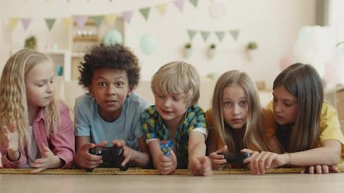 Kids Competing in Video Game