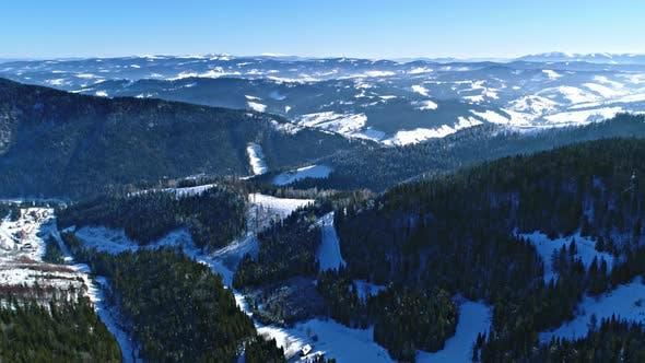 Cover Image for Aerial - Ski Lift at Ski Resort in Sunny Carpatian Mountains