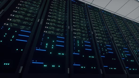 Network and data powerful servers behind glass panels in a server room of a data center or ISP.