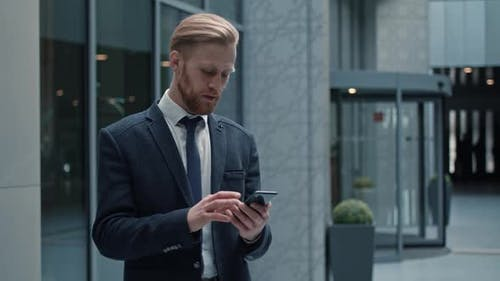 Handsome Bearded Startup Businessman Using Mobile Phone