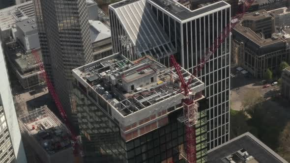 Thumbnail for AERIAL: Super Close Up View of Skyscraper Construction Site in Urban Environment with City Car