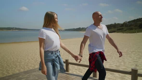Thumbnail for Smiling Couple Walking on Beach Together