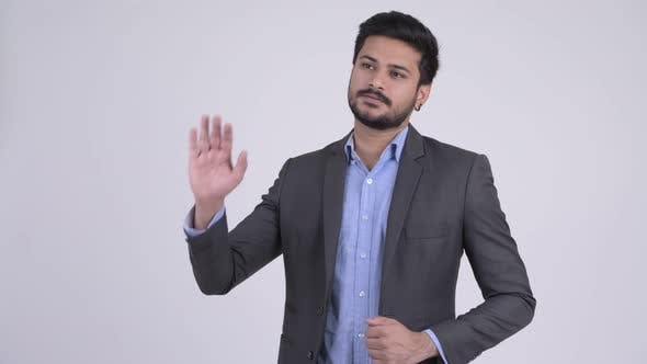 Thumbnail for Young Handsome Bearded Indian Businessman Waving Hand