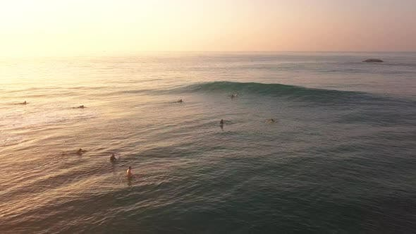 Thumbnail for Surfers in the Ocean at Sunrise. Active Holiday at Sea
