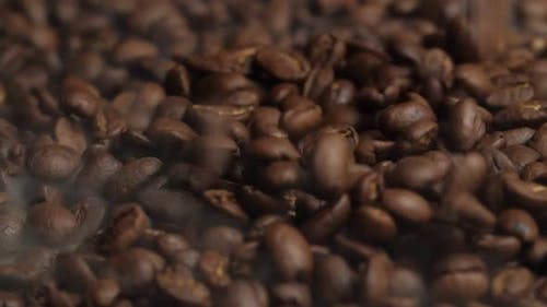 Falling Roasted Coffee Beans With Smoke