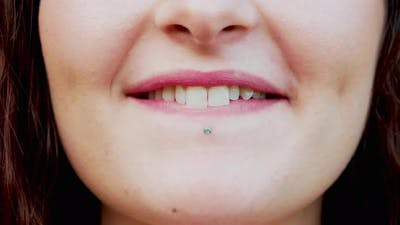 Young woman's pierced lips, Italy