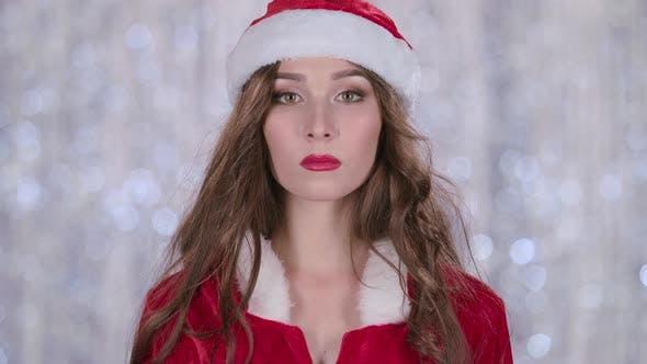 Thumbnail for Santa Girl Starts Smiles. Bokeh Background. Slow Motion