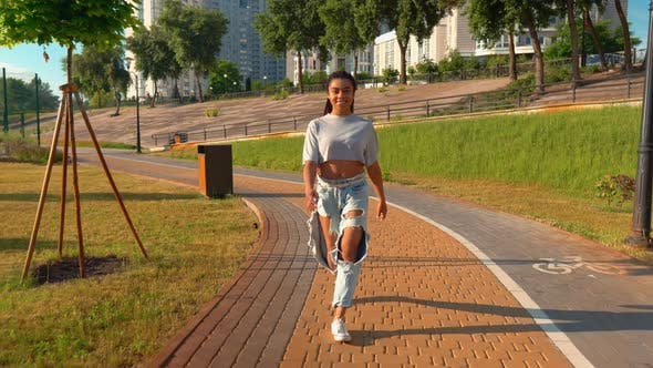 Thumbnail for Smiling Mixed Race Female Stroll Outdoors Cityscape Background Sunlight