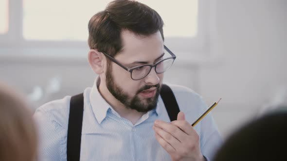 Thumbnail for Close-up Portrait of Young Successful Serious Businessman Having Coffee, Thinking at Modern