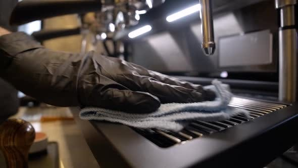 Thumbnail for Male Hand Cleaning Coffee Machine with Napkin