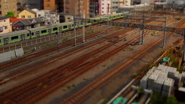 Thumbnail for Looking down at trains going by in Tokyo Japan