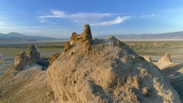 Thumbnail for The Collection of Massive Stone Spires in the Middle of the Flat, Dusty, Hot Desert