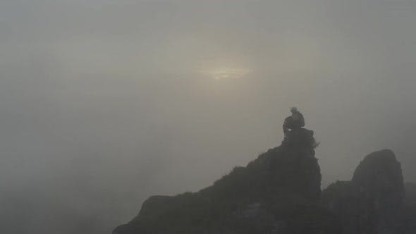 Thumbnail for Man In The Fog On A Rock
