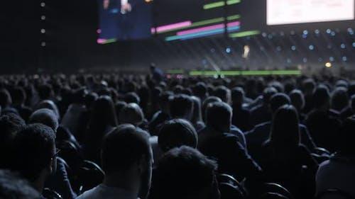 Spectators Sit on Seats in Break of Concert