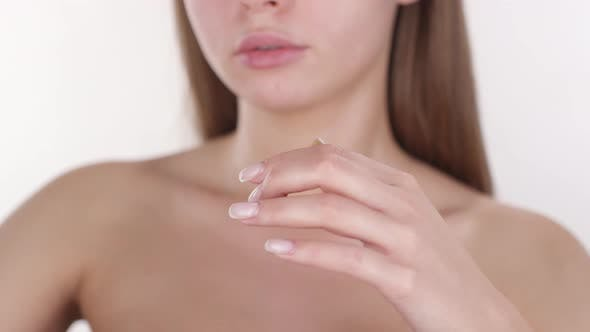Thumbnail for Sensual Woman Applying Foundation to Collarbone