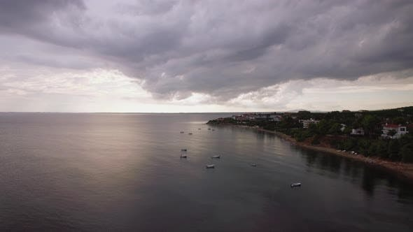 Thumbnail for Coastal Resort, Sea and Grey Clouds in the Sky, Aerial. Trikorfo Beach, Greece
