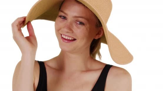 Thumbnail for Cute millennial girl wearing floppy sunhat and smiling on white background