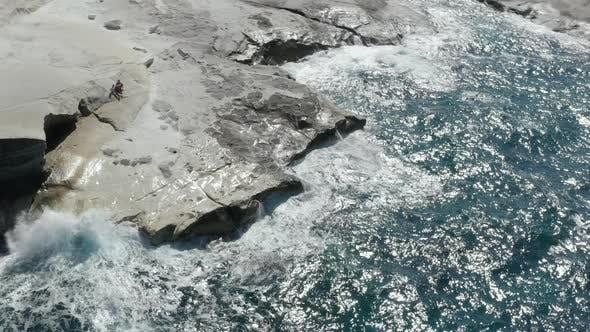 Thumbnail for Aerial View of Sarakiniko Lunar Volcanic Beach with Waves Crashing Into Rocks in Milos, Greece
