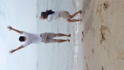 Romantic couple on the beach vacation travel.