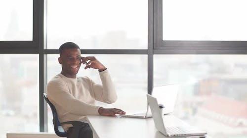 Dark-skinned Businessman Focused on Work Issues