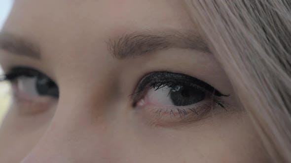 Closeup Shot of a Beautiful Blonde European Woman Opening Her Grey Eyes