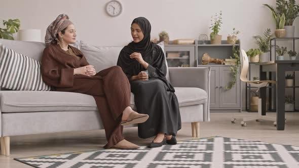 Muslim Girlfriends Talking in Living Room