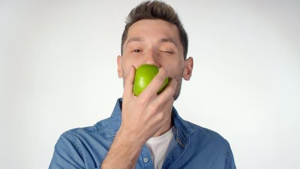 Thumbnail for Portrait of Man Eating Green Apple