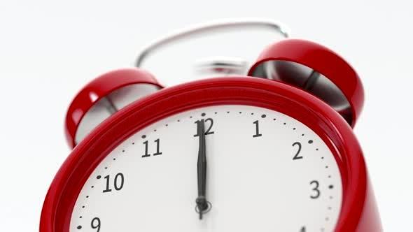Classic alarm clock alarming at 12 o'clock.