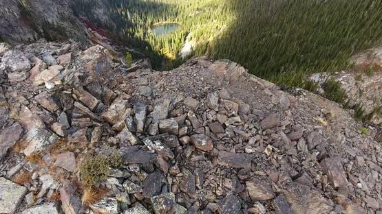 Flight Above Hooknose Mountain Summit Revealing Lake at Base of Mountain