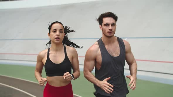Thumbnail for Fitness Couple Running on Athletics Track. Sport Couple Training Together