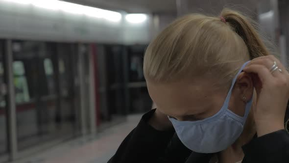 Thumbnail for Woman Putting on Mask in the Subway