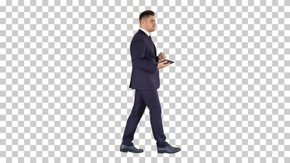Thumbnail for Elegant Young Businessman Using His Pc Tablet While Walking