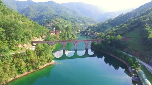 Thumbnail for Flying over river and old stone bridge in Bosnia