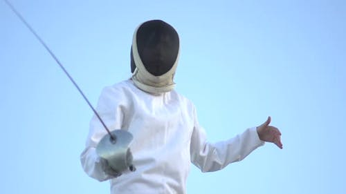 A woman fencing on the beach