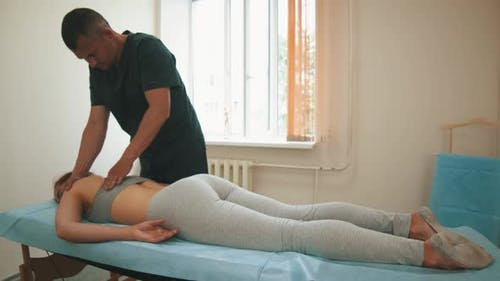 Osteopath Treatment - the Doctor Giving Her a Relaxing Massage