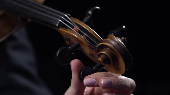 Thumbnail for Musician Girl a Tunes Violin. Black Background. Close Up
