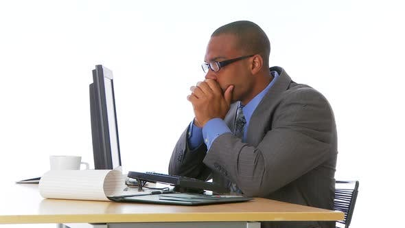 Thumbnail for Concerned businessman with headache at desk