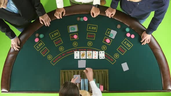 Thumbnail for Group of People in Casino Betting, the Dealer Deals the Cards. Green Screen. Top View