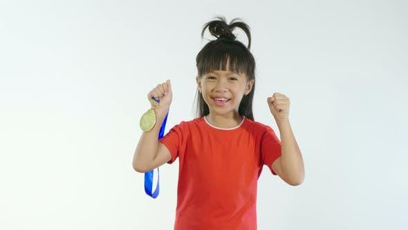 Little Girl Holding Golden Medal And Celebrating