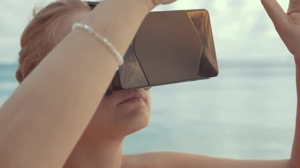 Thumbnail for Woman Entertaining with VR Glasses on the Beach